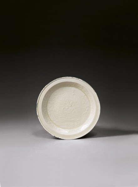 A MOULDED DINGYAO WHITE PORCELAIN 'DUCKS-IN-LOTUS-POND' DISH