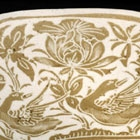 A A CARVED TWO-COLOR DINGYAO PORCELAIN 'DUCKS AND LOTUS' PILLOW