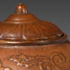 AN IMPERIAL MOULDED GOURD JAR AND COVER