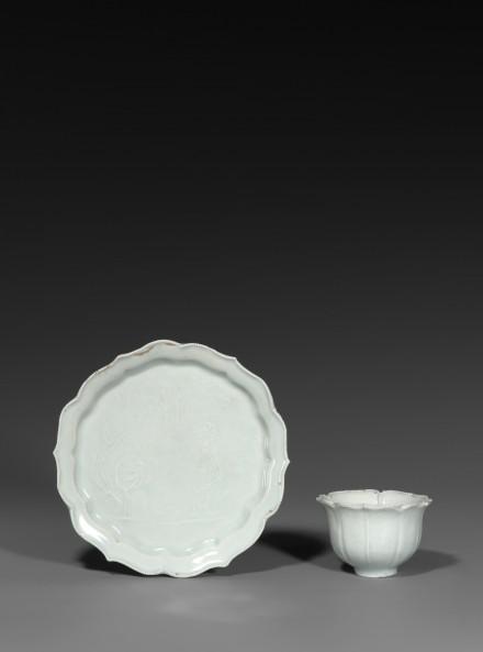 A QINGBAI PRUNUS CUP AND FOLIATE DISH